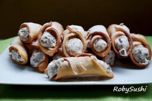 Cannoli con ricotta e cioccolato. Ricetta e foto di Roberta Castrichella.